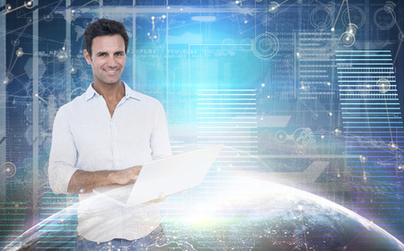 mature men: Portrait of handsome man using laptop against hologram background Stock Photo
