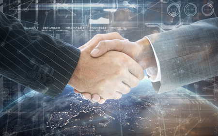 well dressed: Business people shaking hands against image of a earth Stock Photo