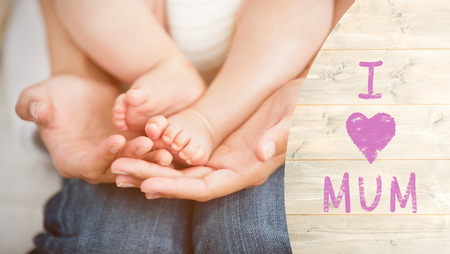 one parent: Mothers day greeting against a mother is holding her son Stock Photo