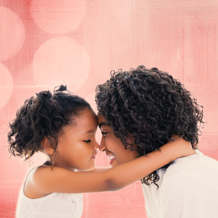 multiracial: Background of multiple color against cute little girl hugging her mother