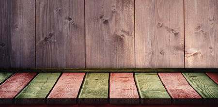 khaki: Red and khaki parquet against wooden background