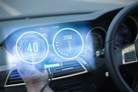 hubcap: Image of a dashboard against man using satellite navigation system Stock Photo