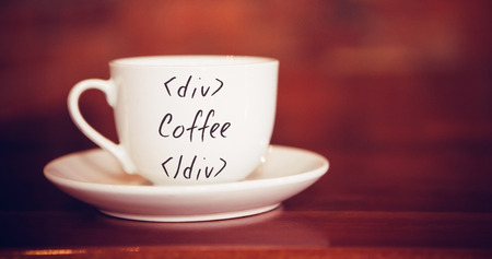 sentence: Sentence against cup and saucer on table in cafe