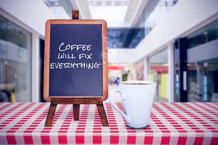 window display: coffee will fix everything against interior of modern shopping mall