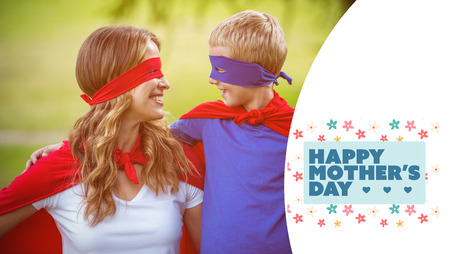 mom and son: mothers day greeting against happy family wearing a disguise
