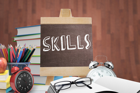 literate: Skills word against red apple on pile of books Stock Photo