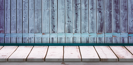 White wall with parquet against wooden background in purple