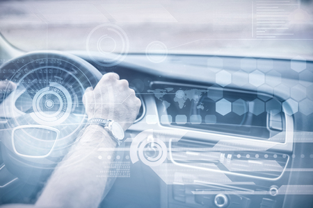 30s: Technology interface against man driving with satellite navigation system Stock Photo