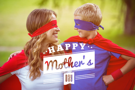 happy family: mothers day greeting against happy family wearing a disguise