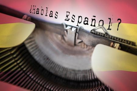 spanish flag: hablas espanol against digitally generated spanish national flag