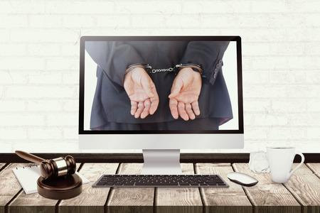handcuffed: Closeup of handcuffed businessman against hammer and gavel