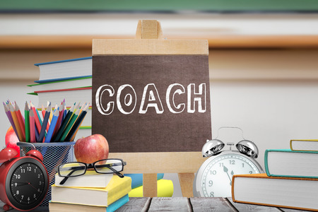 literate: Coach word against red apple on pile of books in classroom Stock Photo