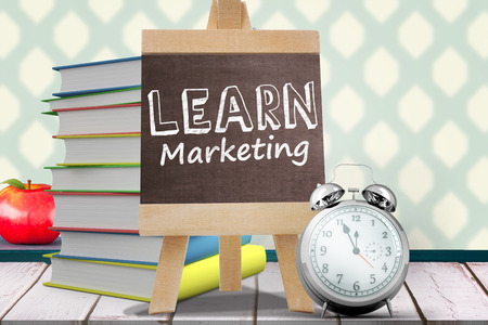 literate: Learn Marketing word against red apple on pile of books