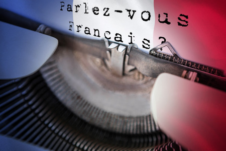 francais: parlez vous francais against digitally generated france national flag Stock Photo
