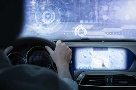 rearview: Technology interface against businesswoman sitting in drivers seat Stock Photo