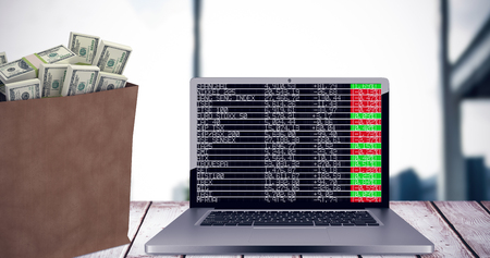 stock price losses: Bag of dollars against documents are posing on the desk Stock Photo