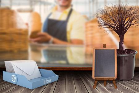 mid adult men: An inbox beside a landscape against smiling worker showing a loaf