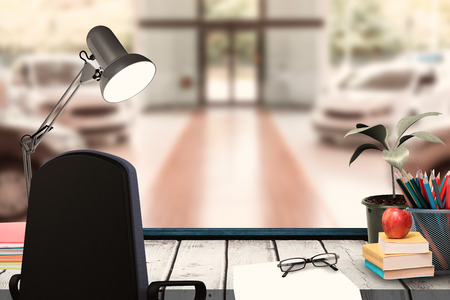 graphic novel: A desk with lamp and documents against view of row new car Stock Photo