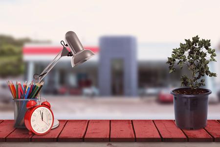 car dealership: School supplies against outside view of car dealership
