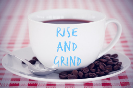 grind: rise and grind against coffee and beans on a tablecloth