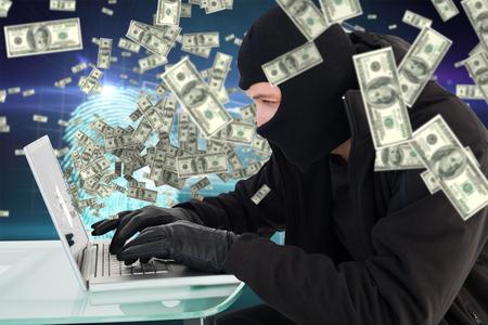 intruding: Robber sitting at desk hacking a laptop  against digital security finger print scan