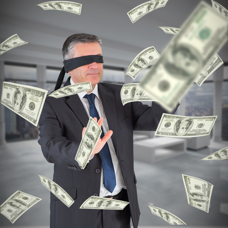 blindfold: Mature businessman in a blindfold against modern room overlooking city