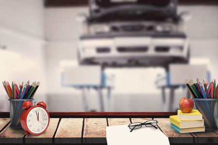 repair shop: School supplies against auto repair shop Stock Photo