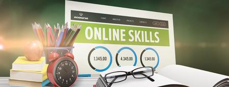apple computers: School supplies on desk against green chalkboard