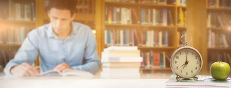 mid adult men: desk against man studying