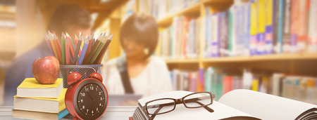mid adult men: School supplies on desk against people looking a book