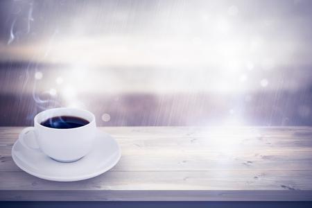 grey sky: cup of coffee against grey sky over ocean