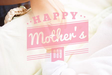 mother holding baby: mothers day greeting against a mother holding her baby hand Stock Photo