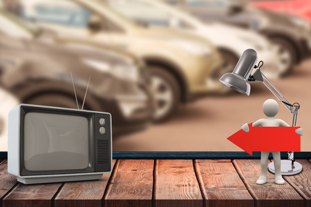 changing channel: An old TV against view of row new car