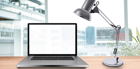 bulding: Desk with laptop against working desk in a office Stock Photo
