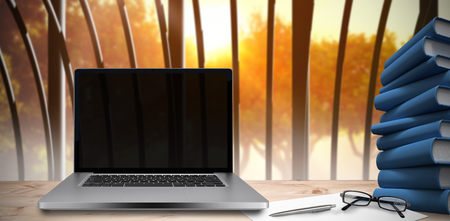 bulding: Desk with laptop against structure on the forest