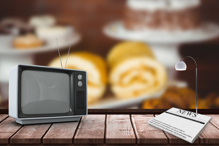 changing channel: An old TV against several treats on the counter