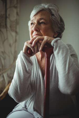 lonesomeness: Thoughtful senior woman sitting in retirement home
