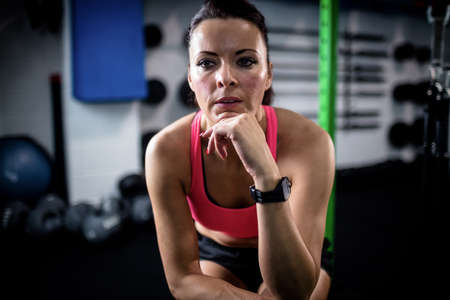 taking a break: Woman taking a break after workout at gym