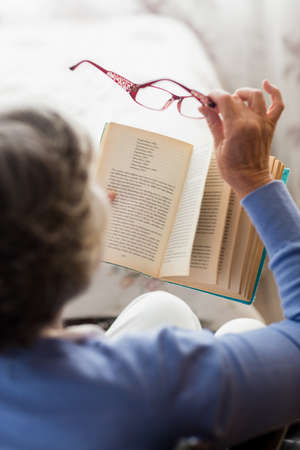 sheltered accommodation: Senior woman reading a book in a retirement home
