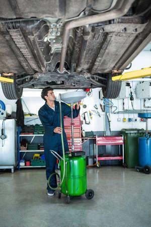 servicing: Mechanic servicing a car at the repair garage