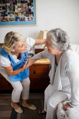 sheltered accommodation: Nurse posing with a senior woman in a retirement home