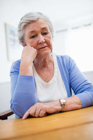 sheltered accommodation: Thoughtful senior woman in a retirement home