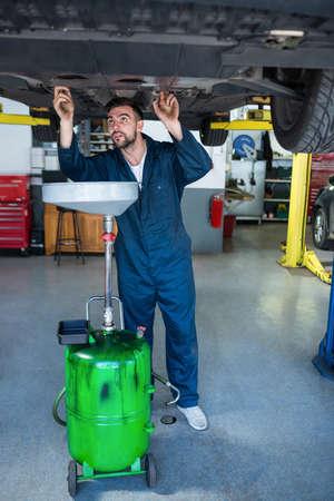 servicing: Mechanic servicing car at the repair garage