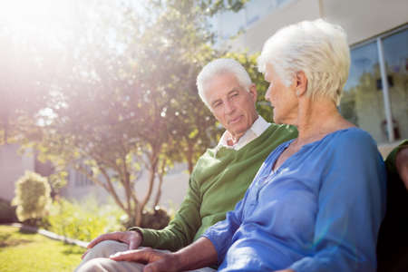 sheltered accommodation: A senior couple looking each other in a retirement home