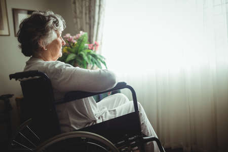 sheltered accommodation: Senior woman sitting in a wheelchair in a retirement home