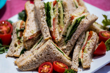 unwholesome: Close-up of sandwiches with cherry tomatoes on plate