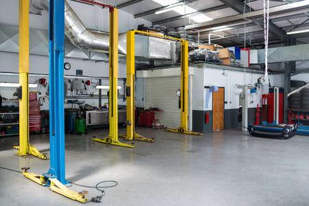 auto repair: Auto repair garage with hydraulic lift