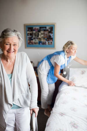 sheltered accommodation: Nurse and senior woman are posing in a retirement home