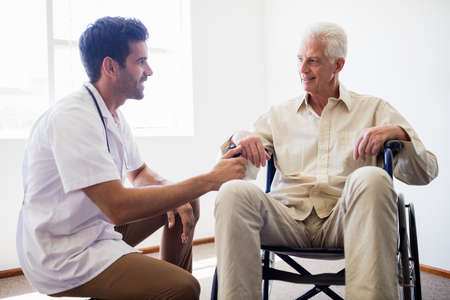 sheltered accommodation: Nurse taking care of a senior man in a retirement home