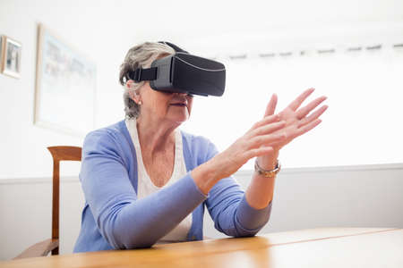 sheltered accommodation: Senior woman using an oculus rift in a retirement home